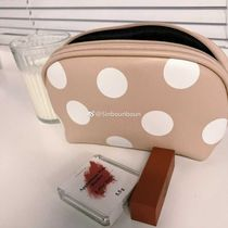 Xin help the Korean portable cute wave point makeup bag women basic zipper simple high-capacity storage bag tide